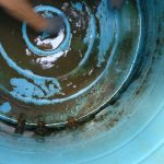 removing-infected-sludge-from-plastic-water-tank