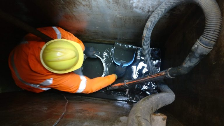 Removing sludge manually form underground water tank